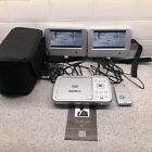 """Acoustic Solutions In car 7"""" Dual Screen DVD Player Good Working Condition"""